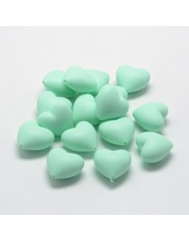 Maistinio silikono karoliukai, širdelės formos,  šviesios žalsvos spalvos, matmenys: 19x20x12mm, skylė: 2mm