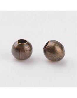 Žalvario spalvos geležiniai intarpai/plombos, be nikelio, matmenys: 2mm diametro, skylė: 0.8mm; 2g./pak.